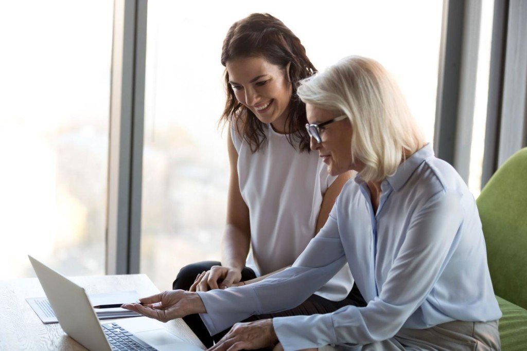 Two women in front of a computer